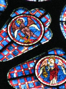 5. Eagle, emblem of St. John, and angel; South Rose, Chartres Cathedral