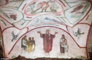 Peacock above Orant Fresco, Rome (photo courtesy of Reuters)